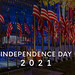 Rockefeller Center during Election Night with a sea of American flags on flagpoles, with the title text Independence Day 2021