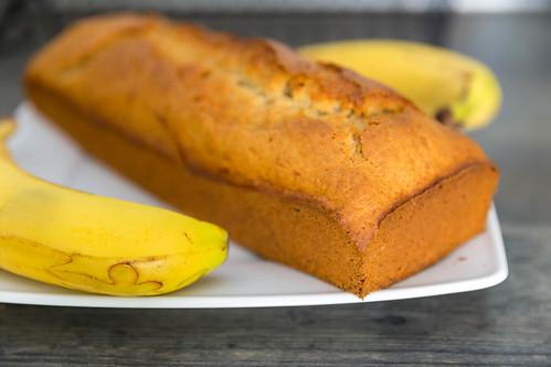 Close-up of homemade crispy banana bread on a white plate