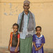 Secare Ahmed, 45, Chief of the Kebele, poses for a picture with his two daughters; (left to right) Medina, 7, and Baskiya, 5.