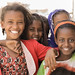 Girls who were lucky to have parents, who said no to FGM, smile for the camera.