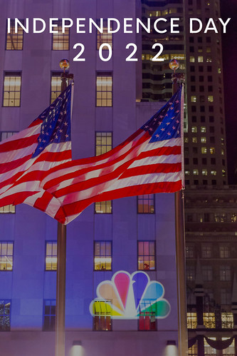 Election Night at Rockefeller Plaza with NBC logo and American flags next to text Independence Day 2022