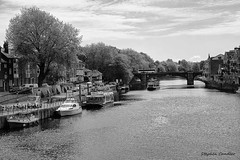 River Ouse (B+W) (Light+Shade [spcandler.zenfolio.com]) Tags: ©stephencandlerphotography spcandler stephencandlerphotography httpspcandlerzenfoliocom stephencandler england uk lightshade blackwhite blackandwhite bw yorkshire york northyorkshire river riverouse boats bridge trees buildings historical history historic water geotagged