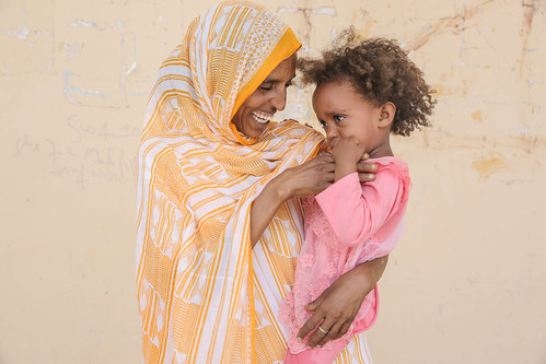 Roza Egihile, 24, with her 2 years old daughter Dimia Egihile. Roza's father used to be a doctor who knew well about the health complications resulting from FGM.