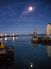 Moonscape (thenorthernmonkey77) Tags: boat blue sky moon moonlit moonlight water harbour sea still calm night clouds wellington newzealand nz olympus omd em5 1442mm kit lens
