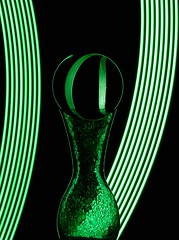Green (Karen_Chappell) Tags: green glass ball orb sphere round circle refraction led glow lights light black vase longexposure lightpainting stilllife curves lines curve arc color colour