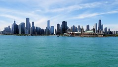 EMERALD LAKE MICHIGAN (Rob Patzke) Tags: chicago navypier lx100 teal emerald lake cityscape sky water building skyscraper boat wheel pier navy clouds color city michigan shoreline beach tall