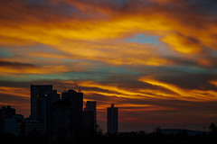 febraury dawn (ikarusmedia) Tags: towers bbva bancomer corporate offices buildings tall skycrappers sky dawn chapultepec park reforma avenue national auditorium morning orange clouds blue mexico city rays