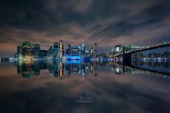 NY Manhattan from Brooklyn II (Luis Cagiao) Tags: manhattan ny nyc new nueva york city skyline skyscraper brooklyn sea river longexposure sky clouds movement reflection