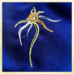 Handbag Embroidery (Julie (thanks for 9 million views)) Tags: material embroidery blue handbag squareformat hipstamaticapp curves macromondays 100xthe2019edition 100x2019 image68100 fashion