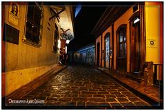 UNA CALLE DE HISTORIA Y DE RECUERDOS. A STREET OF HISTORY AND MEMORIES. (ALBERTO CERVANTES PHOTOGRAPHY) Tags: callenumapompiliollona numapompiliollona calle street guayaquil guayas republicadelecuador ecuador guayaquilecuador gye ecuadorguayaquil ecuadorgye gyeecuador barriolaspeñas laspeñas city nightcolor colornight colorlight indoor outdoor blur night building house retrato portrait sidewall historia history icono iconic reflejo reflection photography photoborder photoart art creative nightscapes luz light color colores colors brillo bright brightcolors people streetphotography mimunicipalidaddeguayaquil municipalidad municipiodeguayaquil municipio nocturno