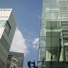 woman going up the spiral stairs (sogni_hal) Tags: architecture building ginza glass tokyo