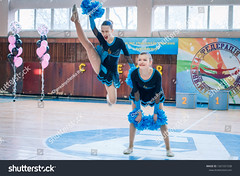 "Kamenskoye, Ukraine - February 18, 2018: Championship KPSK ""Prometheus"" on cheerleading, young cheerleaders perform at the city cheerleading championship (ig_royal6969) Tags: woman child sport dance young cheerleader female team cheerleading pompom teenager athlete cheerful costume performing supporter smiling uniform group happy cheering victory dancer jumping teamwork unity match editorial competition league action game indoor championship jump professional stadium arena college cup dribble girls power score tournament acrobat solo duet ukraine"