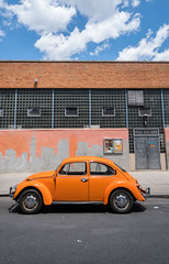 Orange Volkswagen - Long Island City, Queens (ChrisGoldNY) Tags: chrisgolphoto chrisgoldberg chrisgoldny forsale licensing bookcover albumcover sonyimages sonyalpha sonya7rii nyc newyorkcity newyork lic longislandcity queens orange volkswagen urban city street streetphotography cars coches skyline streetart