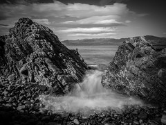 Der Durchbruch (Ulmi81) Tags: black white rock stone sea water bulb exposure long time gravel stones wave motion blur landscape low tide