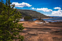 Islands, Sometimes (DavidHenkins) Tags: colorado mountains bridge landscape nature lake islands alone hills water banks pine trees pines clouds sky blue