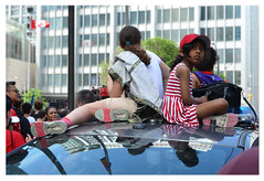 kids on top of police car (mcfcrandall) Tags: kids glass reflections crowd people policecar raptors parade univesityave toronto
