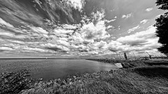 Pulled In (Alfred Grupstra) Tags: nature outdoors blackandwhite sky cloudsky landscape river water scenics bridgemanmadestructure summer sea cloudscape grass nopeople sunset coastline blue architecture travel