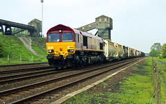 66224 heads a mixed freight past the old Hatfield colliery close to Hatfield & Stainforth Station on 10-5-00. Copyright Ian Cuthbertson (I C railway photo's) Tags: class66 66224 ews shed hatfieldcolliery