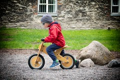young boy riding a wooden bike (ABWphoto!) Tags: europe tallinn estonia park boy playing bike helmet outdoors