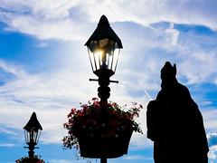 Silhouette Time Again (drasphotography) Tags: würzburg wuerzburg bavaria bayern frankonia franken main mainbrücke sun sonne sky himmel drasphotography nikonphotography nikkor2470mmf28 d810 travelphotography reisefotografie lantern flowers blumen urban