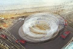 round & round & roundabout (I AM JAMIE KING) Tags: scarborough coast roundabout multipleexposure doubleexposure seaside cars road traffic