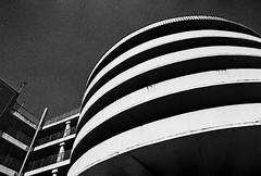 The Romford Curly Wurly (Bosscat2) Tags: nikonfilmcamera nikonfm2 nikkor28mmais ilfordblackandwhitefilm ilfordhp5 ilfordid11 romford essex concretebrutalistarchitecture architecture 1960building carpark