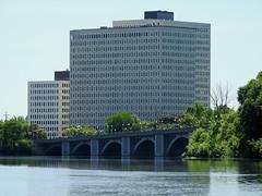 The Cummings Bridge (1921) drawfed by federal government buildings in Vanier (Ottawa), Ontario (Ullysses) Tags: cummingsbridge rideauriver riviererideau ottawa vanier ontario canada spring printemps bridge pont buildings federalgovernment