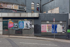 Station Approach (Gary Kinsman) Tags: stationapproach oxfordroad manchester 2019 canon5dmkii canoneos5dmarkii urbanlandscape urban topographics newtopographics architecture canon35mmf2 posters mess abandoned derelict boardedup grey nofx alltimelow