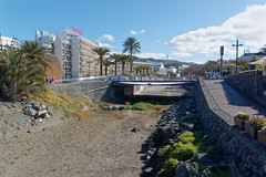 Los Cristianos, Tenerife, Canary Islands (wildhareuk) Tags: canaryislands canon canoneos500d hotel palmtree road spain tamron18270mm tenerife tenerife2019 bridge building path riverbed tamron img9414dxo