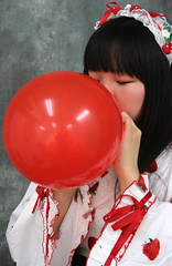 Strawberry Envies Balloon (emotiroi auranaut) Tags: air girl woman lady nice pretty beauty beautiful model clothing bonnet face hair red toy balloon blow grow growing bigger expanding strawberries strawberry eyesclosed trying concentrating breathe breathing blowingupaballoon sweet lovely