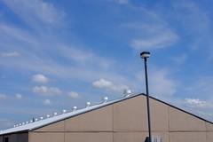 Roof and Sky (Gene Ellison) Tags: building roof white industrisl vents sky fujifilm velvia