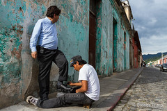 Shoeshine on the streets of Antigua. (brendatharp) Tags: guatemala curbside service antigua centralamerica buildings cobblestone cultural destination streetlife culture adventure shoeshine latin travel traveldestination working outdoor street central people men lane