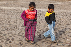 Young Guatemalan boy and girl walking through square. (brendatharp) Tags: guatemala clothing antigua centralamerica walking cultural destination children culture girl latin travel people traveldestination guatemalan nativedress central adventure boy traditional