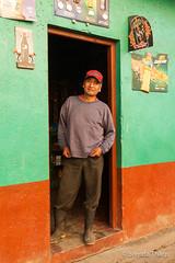 Man standing in doorway of shop in Santa Maria de Jesus. (brendatharp) Tags: guatemala santamariadejesus centralamerica person cultural destination town culture man traveldestination latin friendly guatemalan central adventure travel shop male