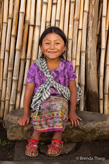 Portrait of a young Guatemalan girl. (brendatharp) Tags: central clothing centralamerica person cultural destination culture adventure guatemala latin friendly santamariadejesus traveldestination travel guatemalan pretty smiling girl happy traditional