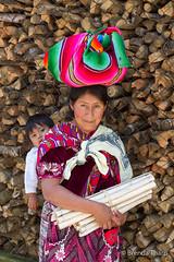 Woman with head bundle and child on her back, San Juan La Laguna. (brendatharp) Tags: guatemala clothing centralamerica cultural destination culture adventure child bundle travel sololá woman firewood guatemalan atitlán traveldestination latin traditional sanjuanlalaguna female