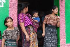 Traditionally dresses Guatemalan women in a shop doorway. (brendatharp) Tags: guatemala women sanjorgelalaguna centralamerica shop cultural destination children culture adventure latin travel girls relaxing atitlán traveldestination store people