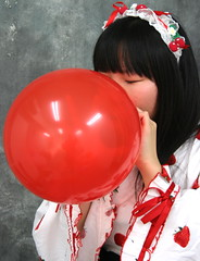 She's Using Both Hands Smartly. (emotiroi auranaut) Tags: air girl woman lady nice pretty beauty beautiful model clothing bonnet face hair red toy balloon blow grow growing bigger expanding strawberries strawberry breathe breathing blowingupaballoon carefully perceptive effort talent talented smart intelligent