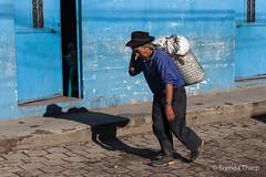 Man, shadow and blue wall, Guatemala. (brendatharp) Tags: guatemala santamariadejesus centralamerica person walking cobblestone cultural destination culture man traveldestination latin travel wallart fineartprint guatemalan walldecor central village adventure bluewall lane male street