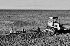 Ploughing the waves (Hidden in the flash.) Tags: blackandwhite bw mono monochrome beach coast sea landscape boats tractor weybourne norfolk boat nikon d3400