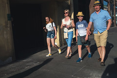 Family Walk (Ktoine) Tags: saintpetersburg russia family candid street man woman kids children yellow blue legs wide width summer light hat sunglasses