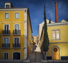 Painted with sun and blue (Pietro Faccioli) Tags: lisbon portugal traditional city town sky blue evening skyline houses chimney windows façade yellow street road stairs escadaria picturesque cypress painterly sunny serene shadow