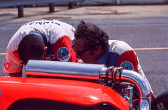 George Bignotti fixes a detail on one of the Sinmast Wildcat/Offy cars (brooklandsspeedway) Tags: poconoraceway pocono pennsylvania indycar
