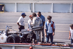 George Snyder talks with the crew of the Lodestar Eagle/Offy he would drive to 10th place in the 1975 Schaefer 500 (brooklandsspeedway) Tags: poconoraceway pocono pennsylvania indycar