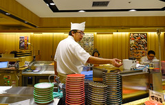 A male cook prepares sushi in the restaurant (phuong.sg@gmail.com) Tags: board bamboo chef chumaki food fish cooking closeup dinner cuisine close cucumber cook fresh delicious eat kitchen japan lunch japanese healthy hands hand knife gourmet male restaurant raw rice professional mat meal roll making preparation prepare seaweed sushi table traditional salmon rolling