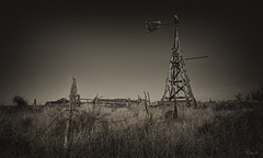 Wooden Windmill_DSC0029 (RRobertsphoto) Tags: newmexico windmill wooden highplains fence barbed wire post