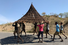 Moving the Roof (2019 AFR D02-0006) (Butterflies in Still Air) Tags: konso traditional house roof moving