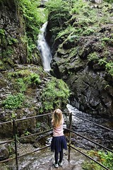 Watching The Water Fall (Light+Shade [spcandler.zenfolio.com]) Tags: ©stephencandlerphotography spcandler stephencandlerphotography httpspcandlerzenfoliocom stephencandler england uk lightshade trees harriet water waterfall girl rocks airaforce lakedistrict cumbria ullswater country countryside nationaltrust nature