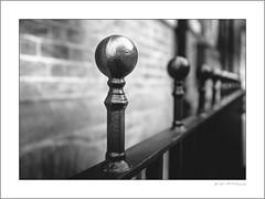Fence finials (G. Postlethwaite esq.) Tags: bw fujx100t sheffield stpetersclose unlimitedphotos blackandwhite fence finial monochrome photoborder wall
