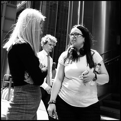 She Said What? (NickD71) Tags: fuji fujifilm xt1 mirrorless csc fujinon xf1855 snapseed london united kingdom mono monochrome street candid compact daily life people canary wharf lunchtime office worker workers discuss discussion conversation facial expression